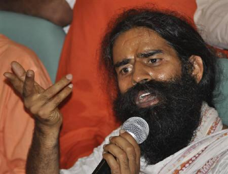 Yoga guru Swami Ramdev speaks during a news conference in Haridwar June 5, 2011. Police broke up a mass fast against graft led by Ramdev on Sunday, risking more political headaches for the scandal-tainted government. REUTERS/Stringer