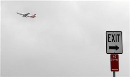 A Qantas passenger plane takes off from Sydney airport May 31, 2011. REUTERS/Tim Wimborne