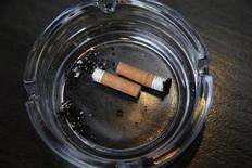 <p>An ashtray with cigarette butts is seen outside a restaurant, in London March 9, 2011. REUTERS/Stefan Wermuth</p>