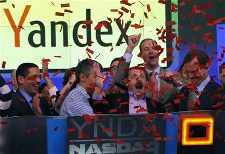 Yandex founder and CEO Arkady Volozh (front, 2nd R) celebrates as Yandex is listed on the Nasdaq exchange during their IPO at the Nasdaq market site in New York May 24, 2011. REUTERS/Mike Segar