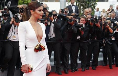 Pop singer Cheryl Cole arrives on the red carpet for the screening of the film ''Habemus Papam'' (We Have A Pope) in competition at the 64th Cannes Film Festival, May 13, 2011. REUTERS/Vincent Kessler