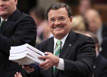 <p>Finance Minister Jim Flaherty prepares to deliver his budget in the House of Commons on Parliament Hill in Ottawa June 6, 2011. REUTERS/Chris Wattie</p>