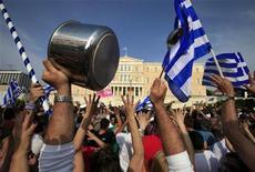 <p>A protester holds up a pot and ladle in front of the parliament building during a rally against a new austerity package at Constitution (Syntagma) square in Athens June 5, 2011. REUTERS/Pascal Rossignol</p>