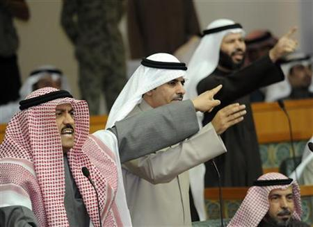 Mussalem al-Barrak (L) and other lawmakers protest the presence of security forces outside the parliament building, ahead of a questioning session of Prime Minister Sheikh Nasser al-Mohammad al-Sabah in Kuwait City December 28, 2010. REUTERS/Stephanie McGehee