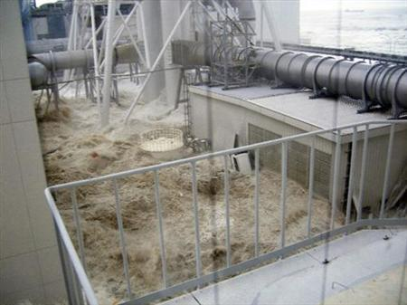 Water rushes into Tokyo Electric Power Co. (TEPCO)'s Fukushima Daiichi nuclear power plant after a tsunami triggered by an earthquake, in Fukushima, in this handout photo taken March 11, 2011, from the fourth floor of the radioactive waste disposal building, and released by TEPCO on May 19, 2011. REUTERS/Tokyo Electric Power Co/Handout