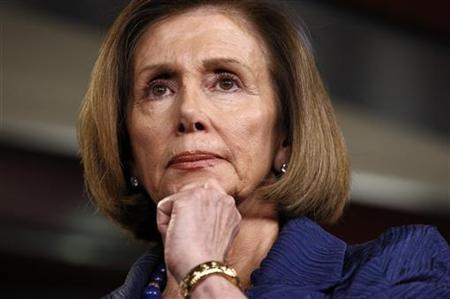 House Minority Leader Nancy Pelosi listens to House Budget Committee ranking member Chris Van Hollen speak about the budget in the Capitol in Washington April 7, 2011. REUTERS/Kevin Lamarque