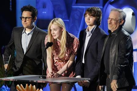 ''Super 8'' director JJ Abrams (L), stars Elle Fanning and Joel Courtney, and producer Steven Spielberg introduce a clip from the film at the 2011 MTV Movie Awards in Los Angeles, June 5, 2011. REUTERS/Mario Anzuoni