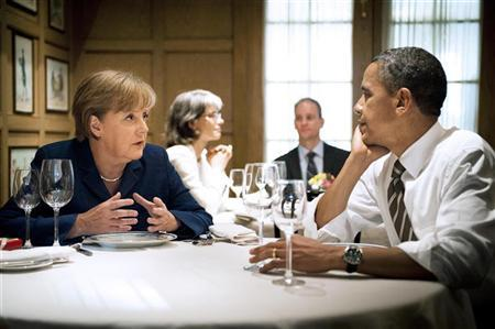 German Chancellor Angela Merkel speaks to U.S. President Barack Obama during a private dinner at the 1789 restaurant in Washington June 6, 2011. REUTERS/Jesco Dezel/Bundesregierung/Pool