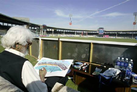 A file photo shows artist Maqbool Fida Husain working on a sketch of Karachi's National stadium during an ODI match between India and Pakistan February 19, 2006. Husain, India's best known painter, died on Thursday at age 95, a close friend of the artist told Reuters. REUTERS/Zahid Hussein/Files