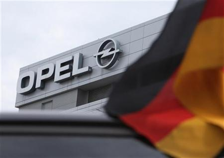 A German flag flatters in the wind in front of the Opel headquarters in Ruesselsheim June 9, 2010. REUTERS/Ralph Orlowski (GERMANY - Tags: BUSINESS TRANSPORT)