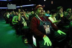 <p>Guest Anthony Parisi is dressed like the videogame character Mario as he attends a Nintendo media briefing during the Electronic Entertainment Expo, or E3, in Los Angeles June 7, 2011. REUTERS/Mario Anzuoni</p>