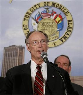 Alabama Governor Robert Bentley address the crowd during a press conference at the Arthur R. Outlaw Convention Center in Mobile, Alabama February 24, 2011. REUTERS/ Lyle W. Ratliff