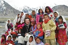 "<p>Greg Mortenson poses with Sitara ""Star"" schoolchildren in Wakhan, northeastern Afghanistan in this undated handout photograph released to Reuters March 11, 2009. REUTERS/Central Asia Institute/Handout</p>"