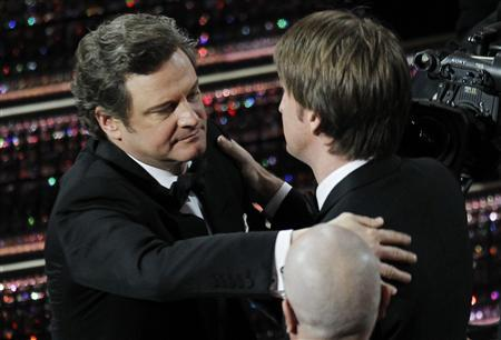 British actor Colin Firth hugs British director Tom Hooper after Hooper won the Oscar for best director for his film ''The King's Speech'' during the 83rd Academy Awards in Hollywood, California, February 27, 2011. REUTERS/Gary Hershorn