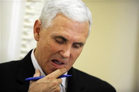 Representative Mike Pence (R-IN) looks at his notes before a news conference about the goal of permanently extending Bush-era tax rates at the Capitol in Washington December 2, 2010. REUTERS/Jonathan Ernst