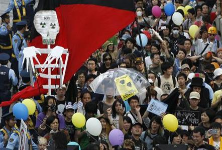 Anti-nuclear protesters take part in a demonstration in Tokyo June 11, 2011, on the three month anniversary of the devastating March 11 earthquake and tsunami which triggered a nuclear disaster. REUTERS/Yuriko Nakao