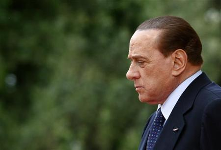 Italian Prime Minister Silvio Berlusconi looks down before a meeting with Palestinian President Mahmoud Abbas at Villa Doria Pamphili, a day after a military parade to celebrate the 150th anniversary of the unification of Italy, in Rome June 3, 2011. REUTERS/Alessia Pierdomenico