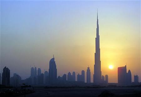 The Burj Khalifa (C) skyscraper is seen as the sun sets over Dubai October 5, 2010. REUTERS/Mosab Omar
