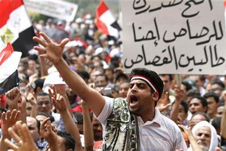 Protesters gesture during a demonstration after Friday prayers in Tahrir square in Cairo, May 27, 2011. REUTERS/Mohamed Abd El-Ghany