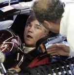 <p>Terry Labonte (L), the two-time NASCAR NEXTEL Cup Series champion, is given last minute instructions as he test drives at the Circuit Gilles Villeneuve in Montreal, June 12, 2007. REUTERS/Christinne Muschi</p>