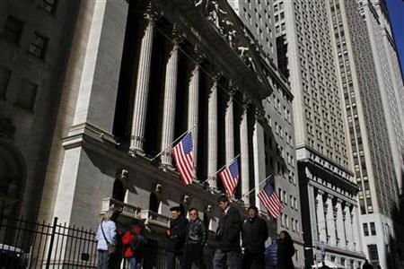 Pedestrians walk past the New York Stock Exchange, February 15, 2011. REUTERS/Joshua Lott