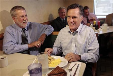 Republican presidential candidate Mitt Romney (R) sits next to supporter Peter Ventura as he makes a breakfast stop at the Senate Coney Island restaurant in Livonia, Michigan June 9, 2011. REUTERS/Rebecca Cook
