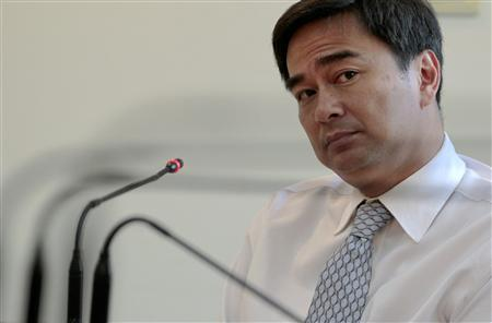 Thailand's Prime Minister Abhisit Vejjajiva ponders questions during an interview with Reuters reporters in Bangkok June 14, 2011. REUTERS/Sukree Sukplang
