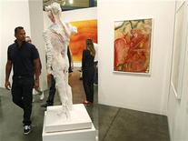 <p>New York Yankees baseball player Alex Rodriquez (L) looks at artwork during a preview of the Art Basel Miami Beach art show at the Miami Beach Convention Center December 1, 2010. REUTERS/Hans Deryk</p>