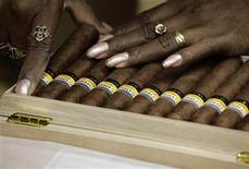 <p>A worker fits Cohiba cigars in a box at the Partagas factory in Havana February 24, 2011. REUTERS/Desmond Boylan</p>