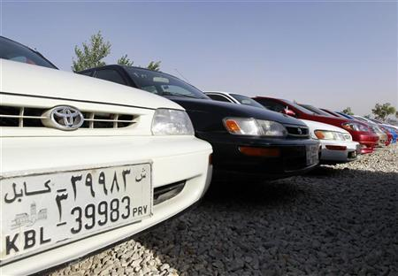 Cars are parked at a car selling lot in Kabul June 14, 2011. REUTERS/Omar Sobhani