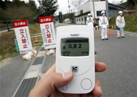 A radiation monitor indicates 0.82 microsieverts per hour at a checkpoint to the restricted zone of a 20km radius around the crippled Fukushima Daiichi Nuclear Power Plant, in Kawauchi village, about 20 km (12 miles) from the plant in Fukushima prefecture, May 10, 2011. REUTERS/Issei Kato