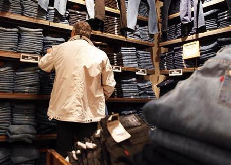 A man shops for blue jeans at a clothing store in New York, December 14, 2010. REUTERS/Shannon Stapleton