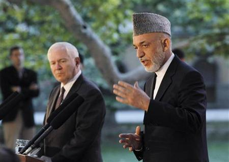 Secretary of Defense Robert Gates (L) listens as Afghanistan's President Hamid Karzai speaks at a news conference at the Presidential Palace in Kabul June 4, 2011. REUTERS/Jason Reed