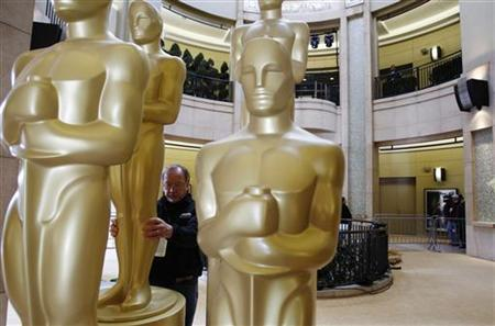 Oscar statues are inspected for blemishes during preparations for the 83rd Academy Awards in Hollywood, California February 26, 2011. REUTERS/Lucas Jackson