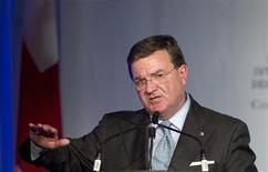<p>Canadian Finance Minister Jim Flaherty speaks at The International Economic Forum of the Americas conference in Montreal, Quebec, June 7, 2011. REUTERS/Christinne Muschi</p>
