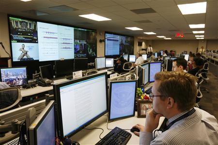 Department of Homeland Security analysts work at the National Cybersecurity & Communications Integration Center (NCCIC) located just outside Washington in Arlington, Virginia in this September 24, 2010 file photo. REUTERS/Hyungwon Kang/Files