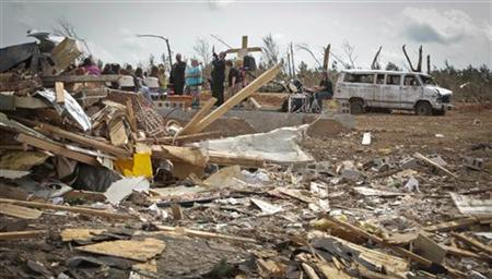 A Sunday church service is held amid devastation, at the site of the Phil Campbell Church of God, destroyed in a deadly tornado April 27, in Phil Campbell, Alabama May 1, 2011. REUTERS/Lee Celano