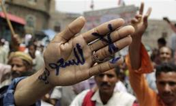 "<p>An anti-government protester displays a message written on his hand during a demonstration to demand the ouster of Yemen's President Ali Abdullah Saleh in the southern city of Taiz June 19, 2011. The message reads, ""No to Saudi Arabia"". REUTERS/Khaled Abdullah</p>"