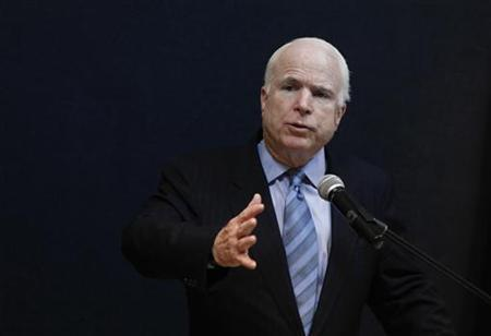Senator John McCain talks to reporters during a news conference at the American Centre in Yangon June 3, 2011. REUTERS/Soe Zeya Tun