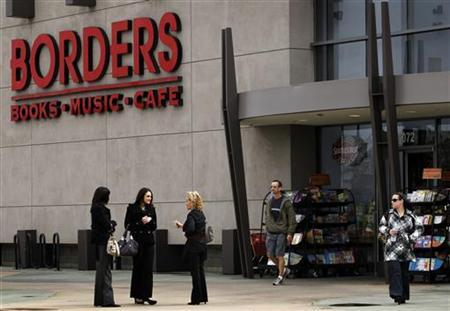 People talk outside a Borders bookstore in San Diego, California February 16, 2011. REUTERS/Mike Blake