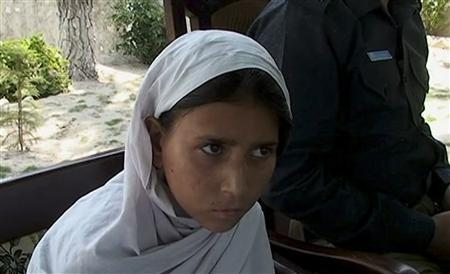 A girl, identified by the police as eight-year-old Sohana Javaid, sits during at a news conference in Lower Dir in this still image taken from video June 20, 2011. REUTERS/Reuters TV