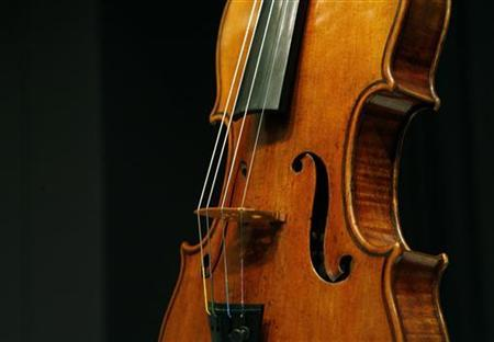 A Stradivarius violin known as ''The Penny'' is displayed at Christie's auction house in New York March 27, 2008. REUTERS/Brendan McDermid