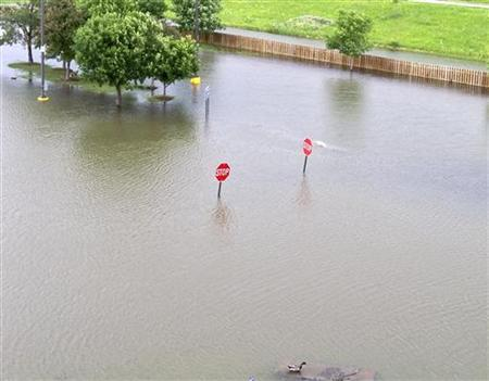A casino parking lot is flooded in Council Bluffs, Iowa, June 9, 2011. REUTERS/Michael Avok