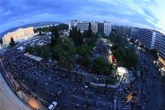 <p>Protesters gather in front of the parliament during a rally against austerity economic measures and corruption, in Athens' Constitution (Syntagma) square June 12, 2011. Picture taken with a Fisheye lens. REUTERS/Pascal Rossignol</p>