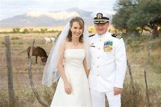 <p>U.S. Representative Gabrielle Giffords (D-AZ) is pictured with her husband NASA Astronaut Mark Kelly in this November 2007 photograph from their wedding made available by the office of Rep. Giffords for Reuters on January 12, 2011. REUTERS/U.S. Rep. Gabrielle Giffords' office/Handout</p>