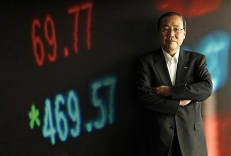 Sumitomo Mitsui Financial Group President Koichi Miyata poses for a picture before the Reuters Rebuilding Japan Summit in Tokyo June 22, 2011. REUTERS/Kim Kyung-Hoon
