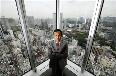Lawson Inc. President and Chief Exective Officer Takeshi Niinami poses for a picture as Tokyo's skyscrapers are in the background before the Reuters Rebuilding Japan Summit in Tokyo June 20, 2011. The Reuters Rebuilding Japan Summit, held June 20-22 in Tokyo, features more than 20 CEOs, government officials and other senior executives discussing the outlook for Japan and how it can bounce back from the crisis. REUTERS/Toru Hanai