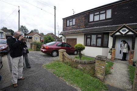 Members of the media gather outside the home of Ryan Cleary, a British teenager arrested in Wickford, eastern England, June 22 2011. REUTERS/Paul Hackett
