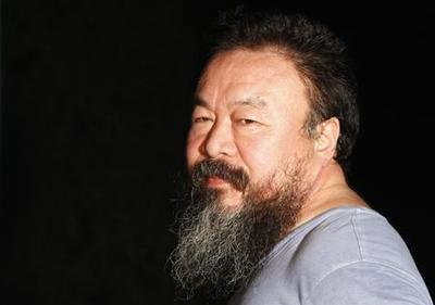 China artist Ai Weiwei stays quiet after freed on bail
