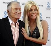 <p>Hugh Hefner and Crystal Harris arrive at the opening night gala of the 2011 TCM Classic Film Festival featuring a screening of a restoration of 'An American In Paris' in Hollywood, California April 28, 2011. REUTERS/Fred Prouser</p>